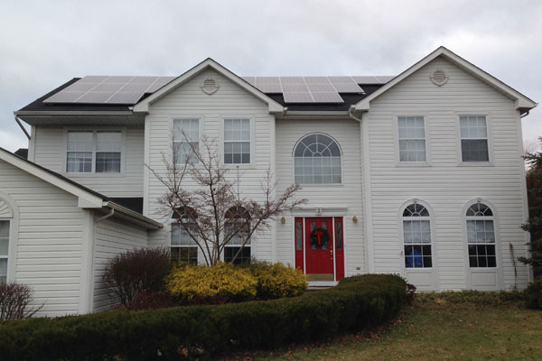 2 story residential home after solar installation